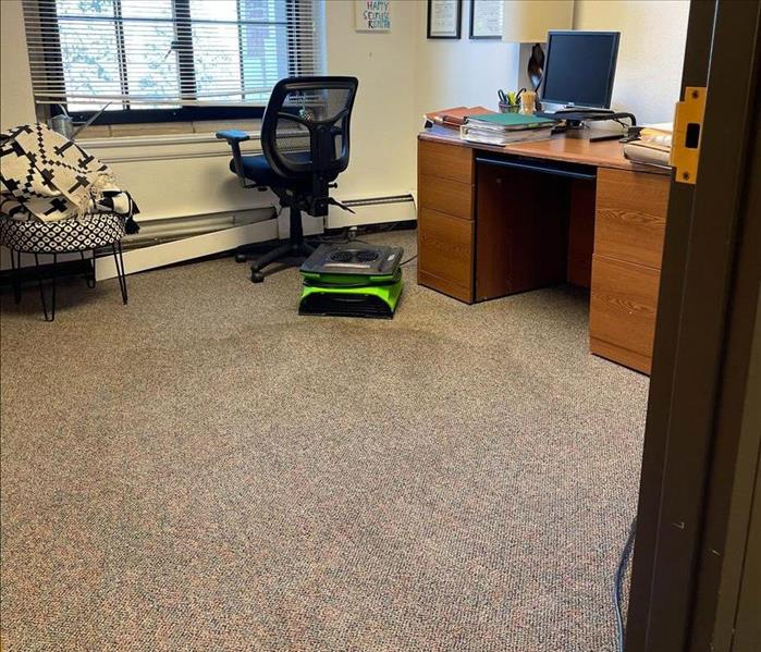 air mover in an office, desk, chair