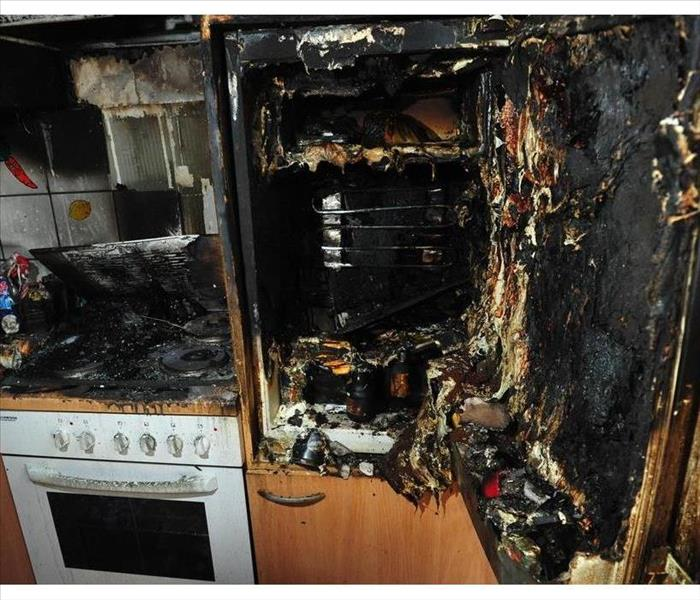 Burned kitchen after fire caused by cigarettes